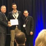 Dr. Sean Smith receiving his certificate for completing the Physiatric Academic Leadership Program at the Association of Academic Physiatrists meeting in Atlanta