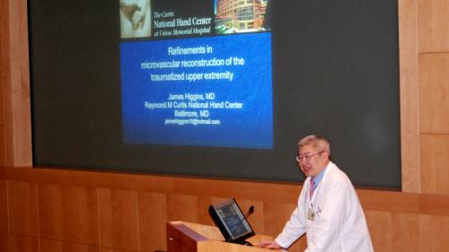 Dr. Chung speaking at a podium