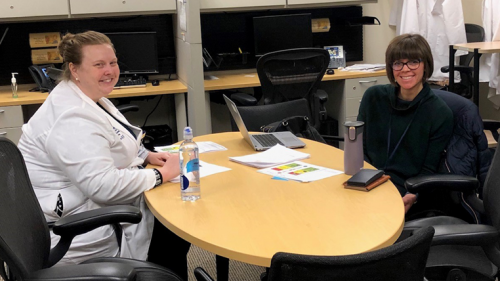 Dr. Rebecca Burmeister and Dr. Christine Jarocki working on patient education materials