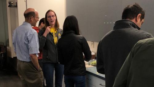 Dr. Richard Auchus talking with Dr. Rachel Reinert