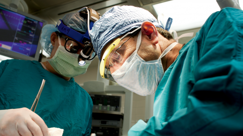 Dr. Ronald Hirschl and team member in the operating room
