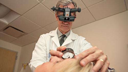 Dr. Mark Johnson examining a patient
