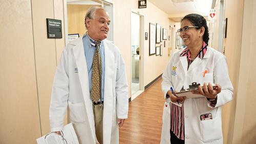 Dr. Terry Smith in a clinic hallway at the Kellogg Eye Center
