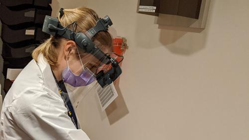 protective shield for an indirect ophthalmoscope