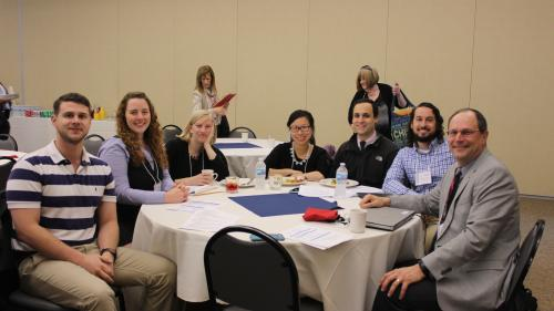 Residents and Dr. Eric Skye at MI Research day